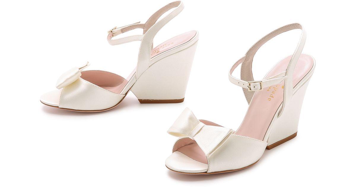 12e41b4e38a Lyst - Kate Spade Imari Wedge Sandals - Ivory in White
