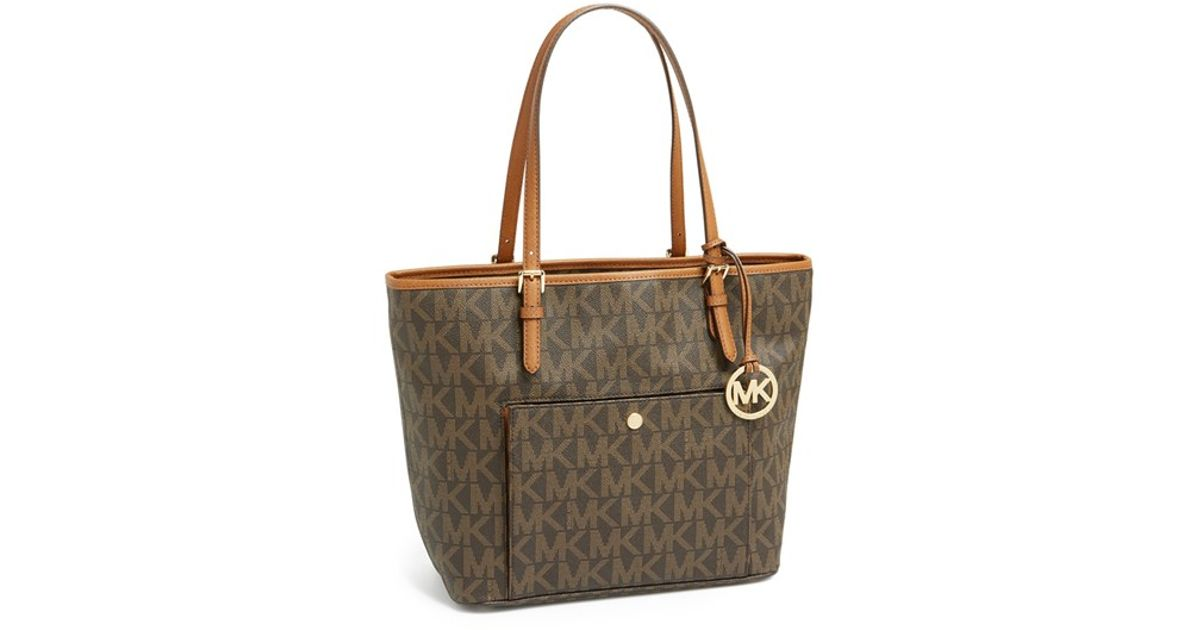 Lyst - MICHAEL Michael Kors  large Jet Set  Signature Snap Pocket Tote in  Brown e8beccb335