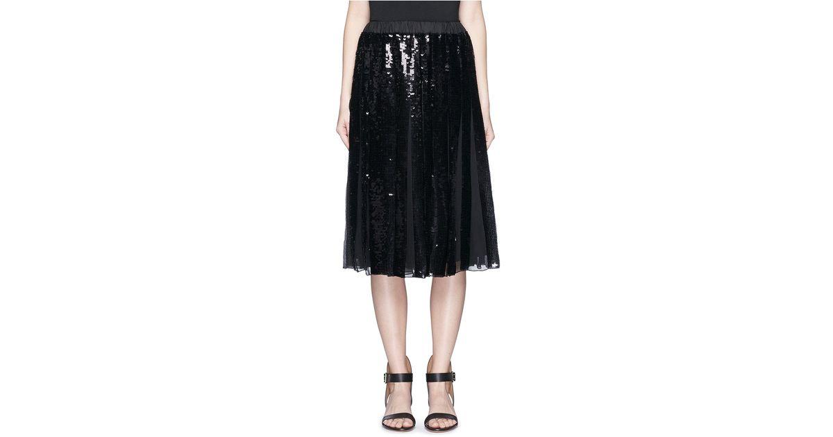 tibi 233 clair sequin pleat midi skirt in black lyst