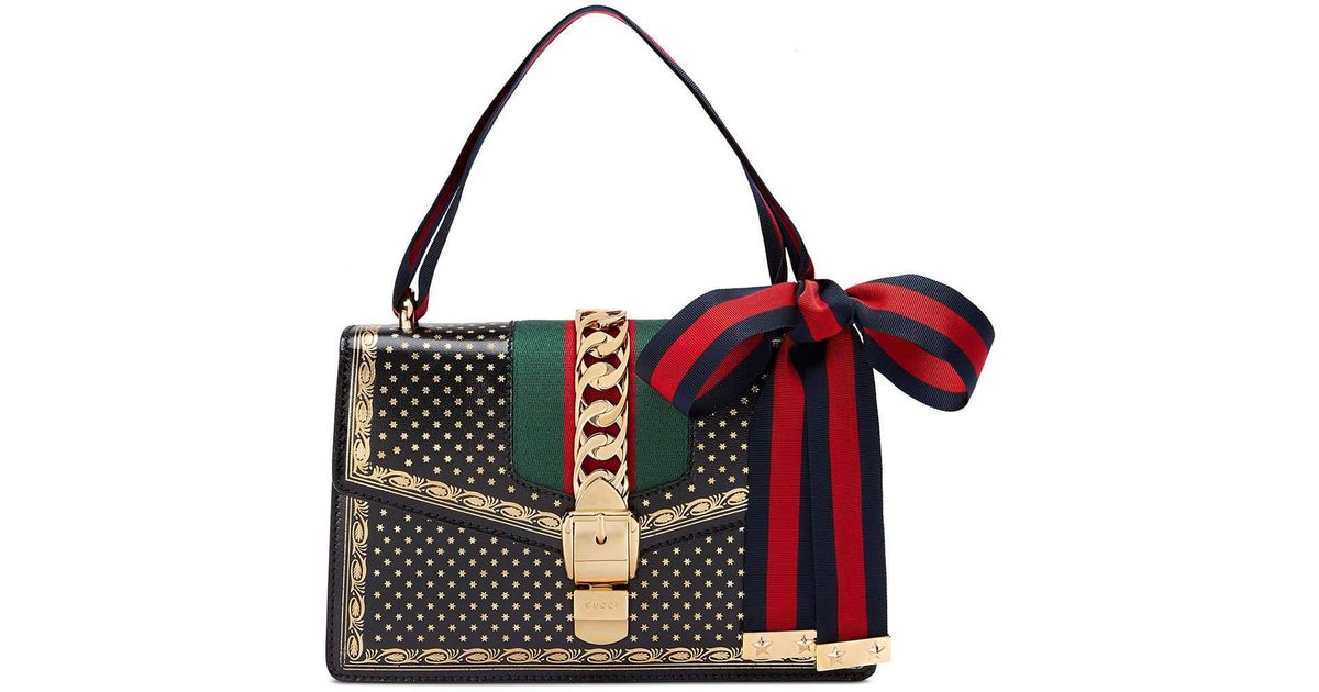 362fb597d80ada Gucci Sylvie Small Stars Leather Shoulder Bag in Red - Lyst