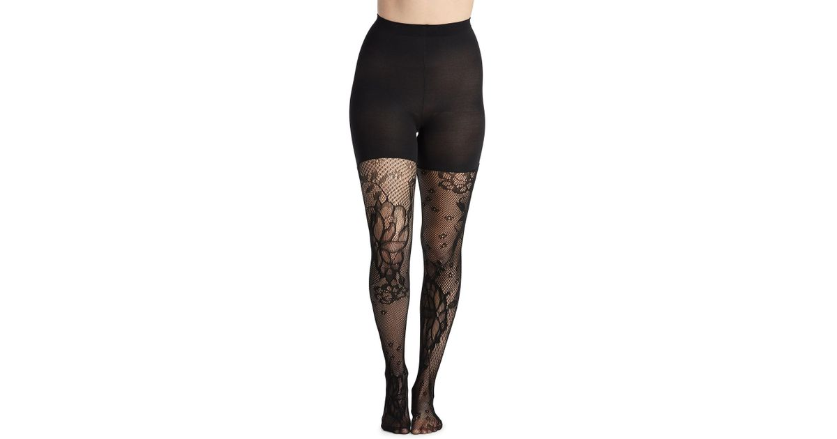 218076a9af Lyst - Spanx Mid-thigh Shaping Floral-fishnet Tights in Black