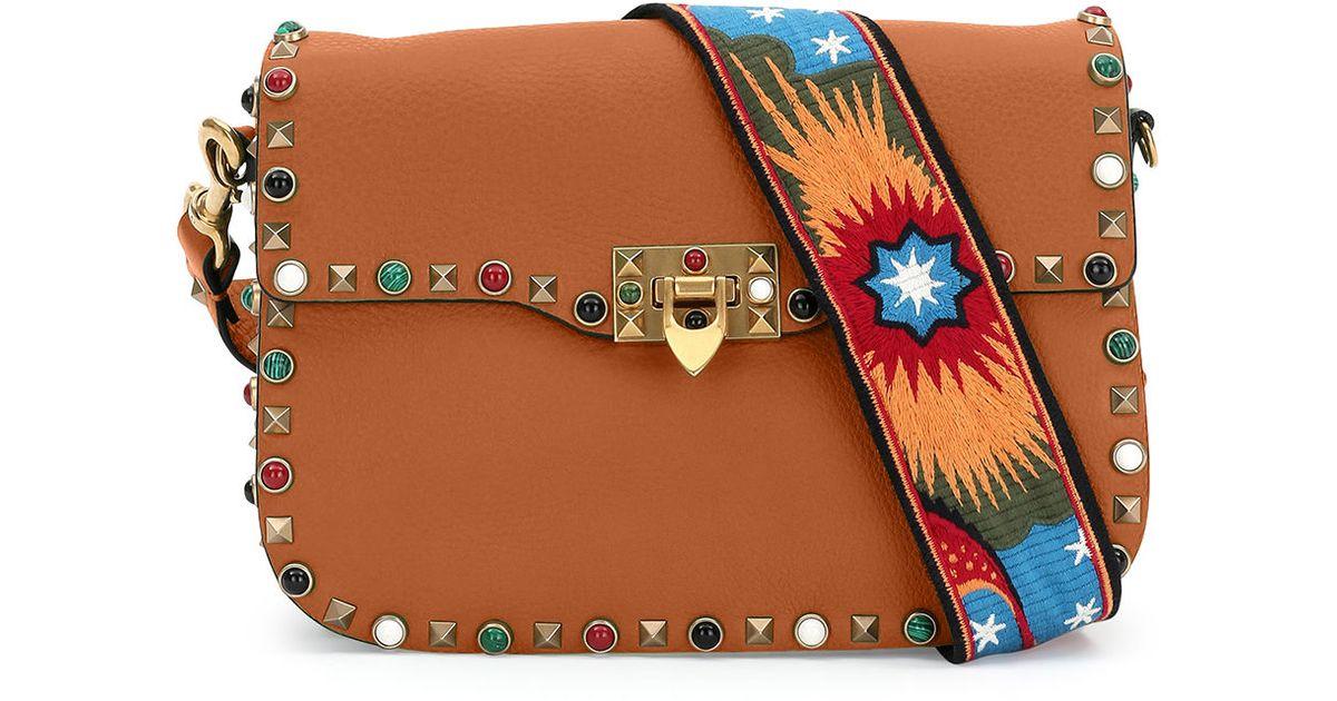 1ba7594a5c Lyst - Valentino Rockstud Rolling Medium Enchanted Guitar-strap Shoulder Bag  in Brown