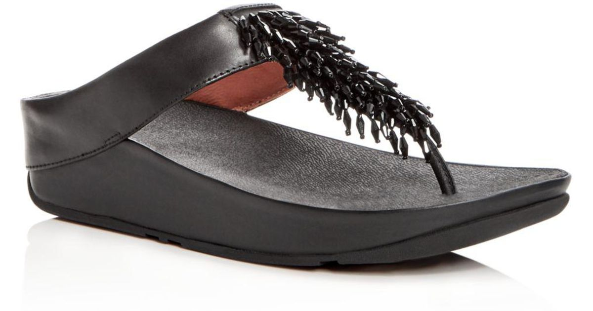 4e45ff1b4888e1 Lyst - Fitflop Women s Rumba Leather Embellished Wedge Thong Sandals in  Black