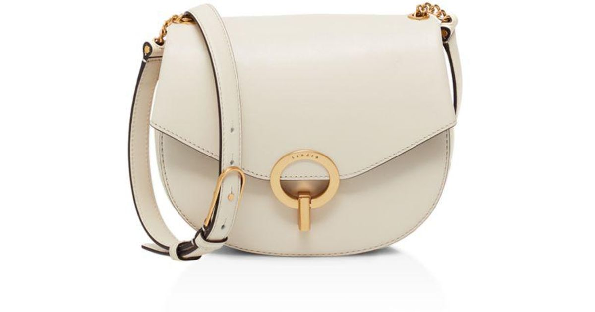 22dee7918981 Lyst - Sandro Pepita Leather Saddle Bag