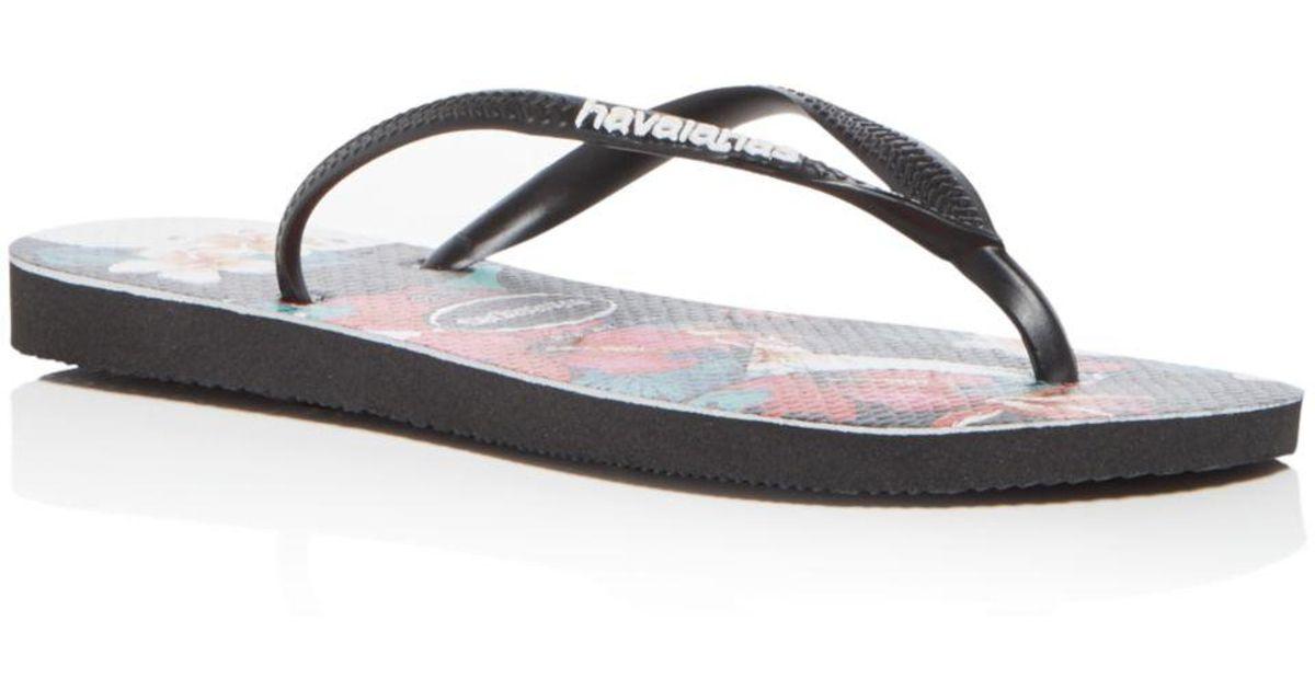 4ec7c7b0df45e9 Havaianas Women s Tropical Floral Slim Flip-flops in Black - Lyst