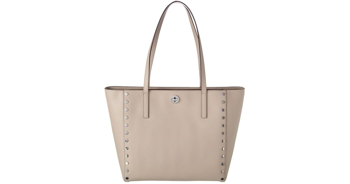 b340690235 ... get lyst michael michael kors rivington stud large leather tote 5200f  96862