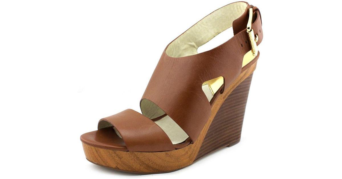 69a19146598 Lyst - Michael Michael Kors Carla Platform Wedge Women Leather Tan Wedge  Sandal