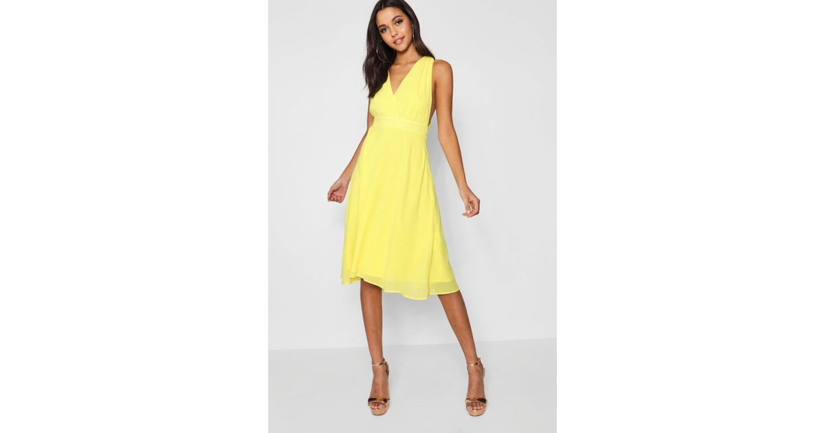 1369a4cc991a Lyst - Boohoo Boutique Chiffon Wrap Midi Skater Dress in Yellow