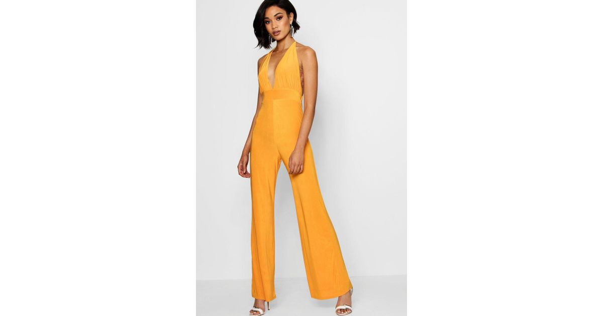 e72ba0810043 Boohoo Strappy Deep Plunge Jumpsuit - Lyst