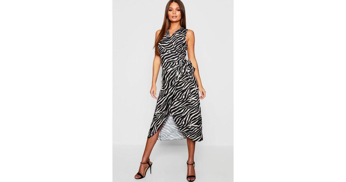 75320d9a3aa7 Lyst - Boohoo Woven Tiger Print Wrap Dress in Black