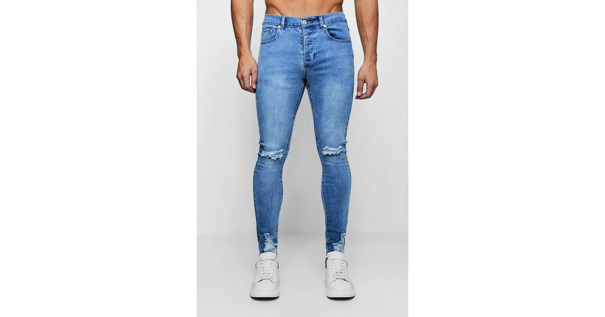 c77194276db6 Lyst - BoohooMAN Super Skinny Jeans With Distressed Knee And Hem in Blue  for Men - Save 11%