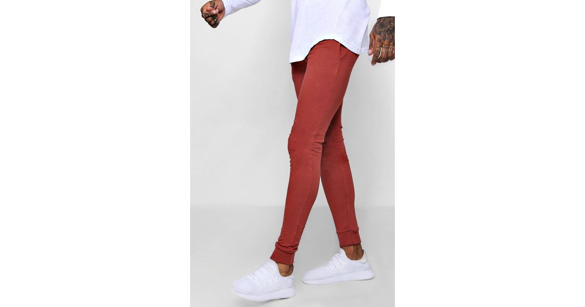 8545a8c0 BoohooMAN Super Skinny Joggers in Red for Men - Lyst