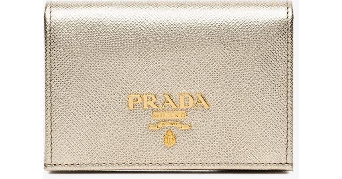 8486adad280312 ... new zealand lyst prada metallic gold logo saffiano leather wallet in  gray b484e 2b6a2