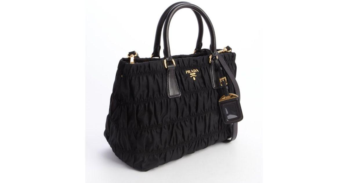 00dfa638635324 ... italy lyst prada nylon tessuto gaufre top handle small tote in black  5d42a e98f5 ...