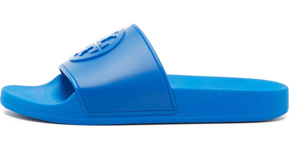 7221d62da548 Lyst - Tory Burch Jelly Flat Slides in Blue