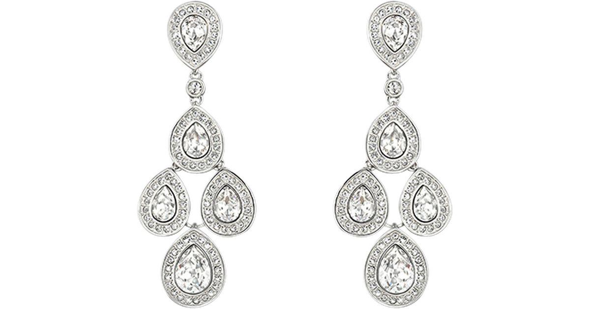 ee6bf6152 Lyst - Swarovski Sensation Pierced Earrings in Metallic