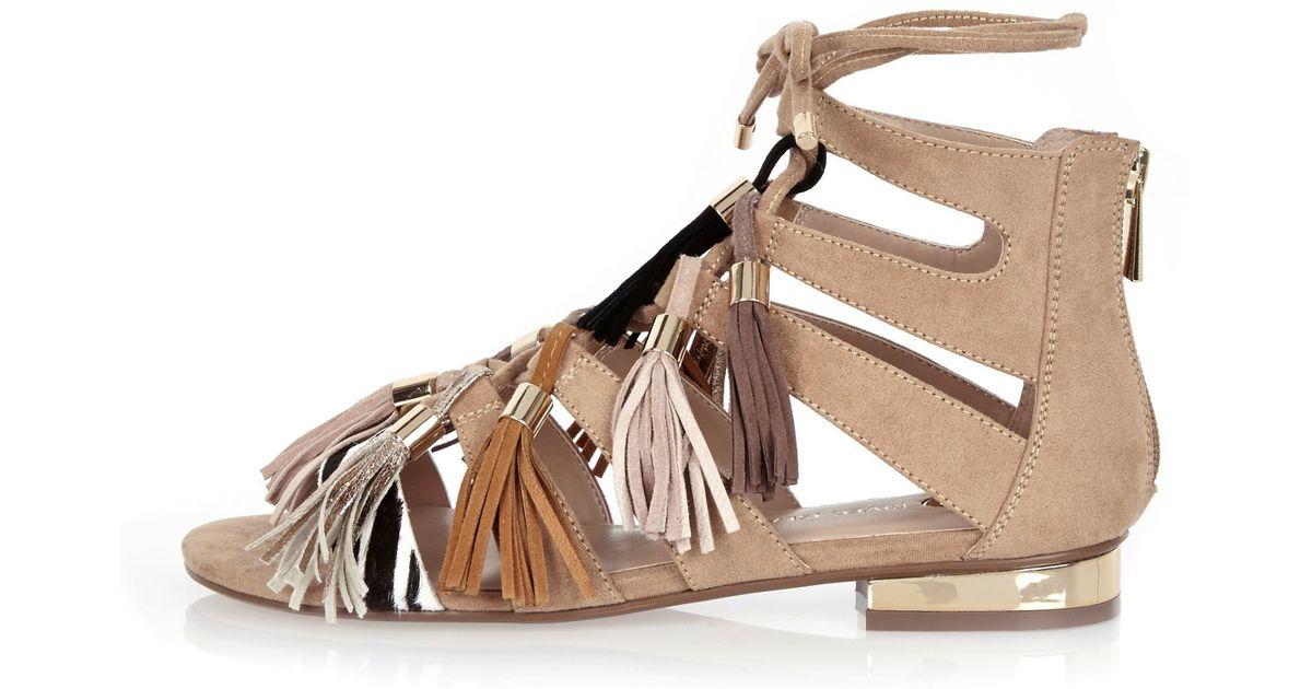 cfda4cd95196 Lyst - River Island Nude Tassel Gladiator Sandals