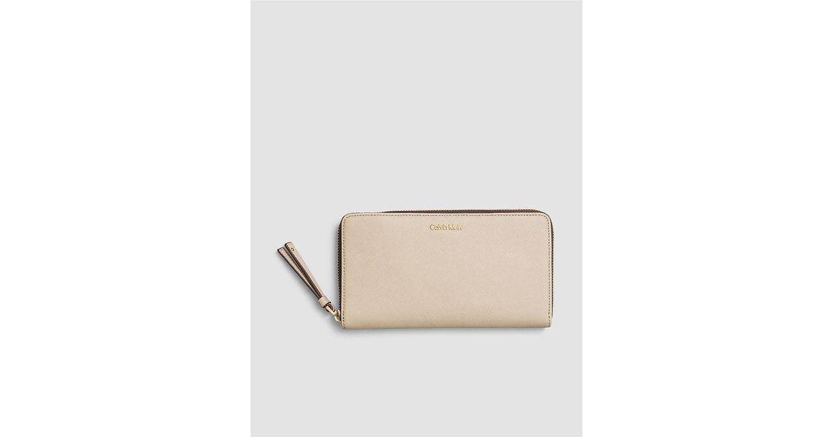 e141cea5b296 Lyst - Calvin Klein Jeans Saffiano Large Zip Wallet