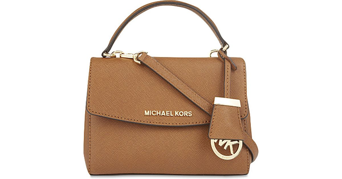 eb305c94abff Lyst - MICHAEL Michael Kors Petite Ava Extra Small Saffiano Leather Cross  Body Bag in Brown