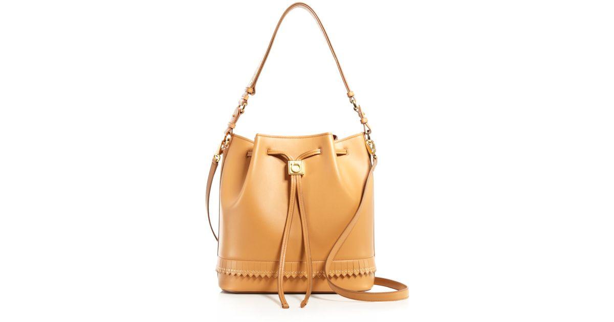 Lyst - Ferragamo Bloomingdale s Exclusive Sansy Grommet Fringe Drawstring  Shoulder Bag in Brown 095551372670a