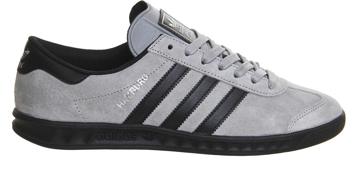 grey and black adidas hamburgs