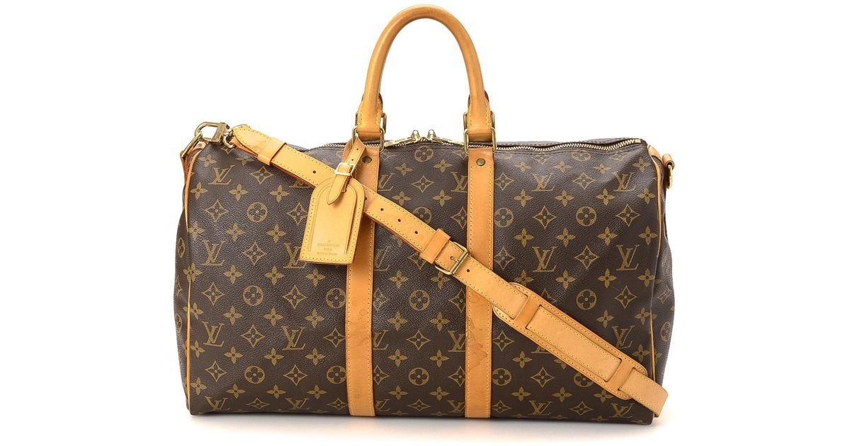 e0655a47e013 Lyst - Louis Vuitton Keepall 45 Bandouliere Travel Bag - Vintage in Brown