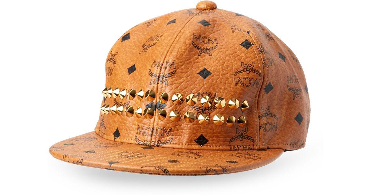865b3fde72487 ... authentic mcm mcm bucket hat lyst mcm cognac studded stark cap in  natural 6a5ba d7320
