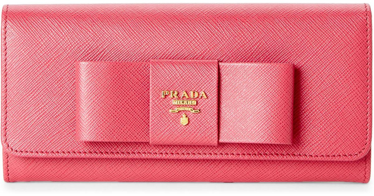 3e7558ae35ba ... new arrivals lyst prada pink fiocco bow wallet clutch in pink 1dbfc  46ebf ...