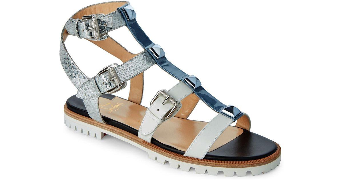 186f84763bfe ... sweden lyst christian louboutin poseidon rocknbuckle studded caged flat sandals  in blue 2b4c6 ddf89
