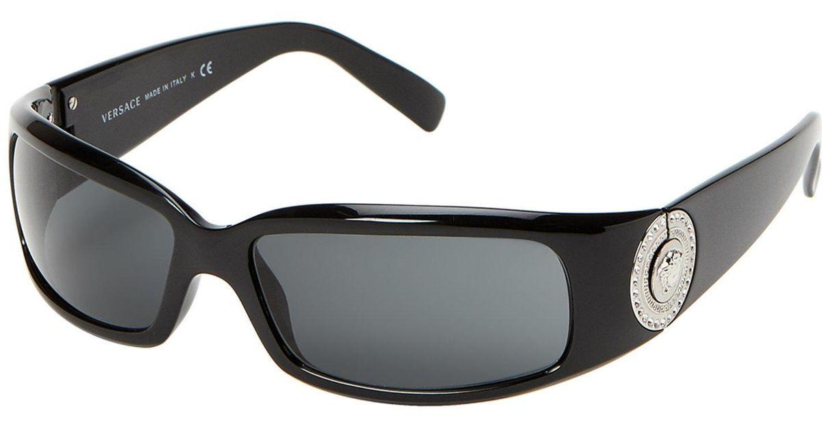df3036b93e13 Lyst - Versace Ve4044 Black Wrap Around Sunglasses in Black