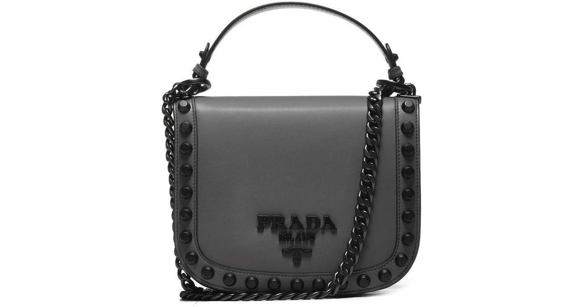6b635b3efa7d9f Lyst - Prada Logo Plaque Studded Bag in Gray