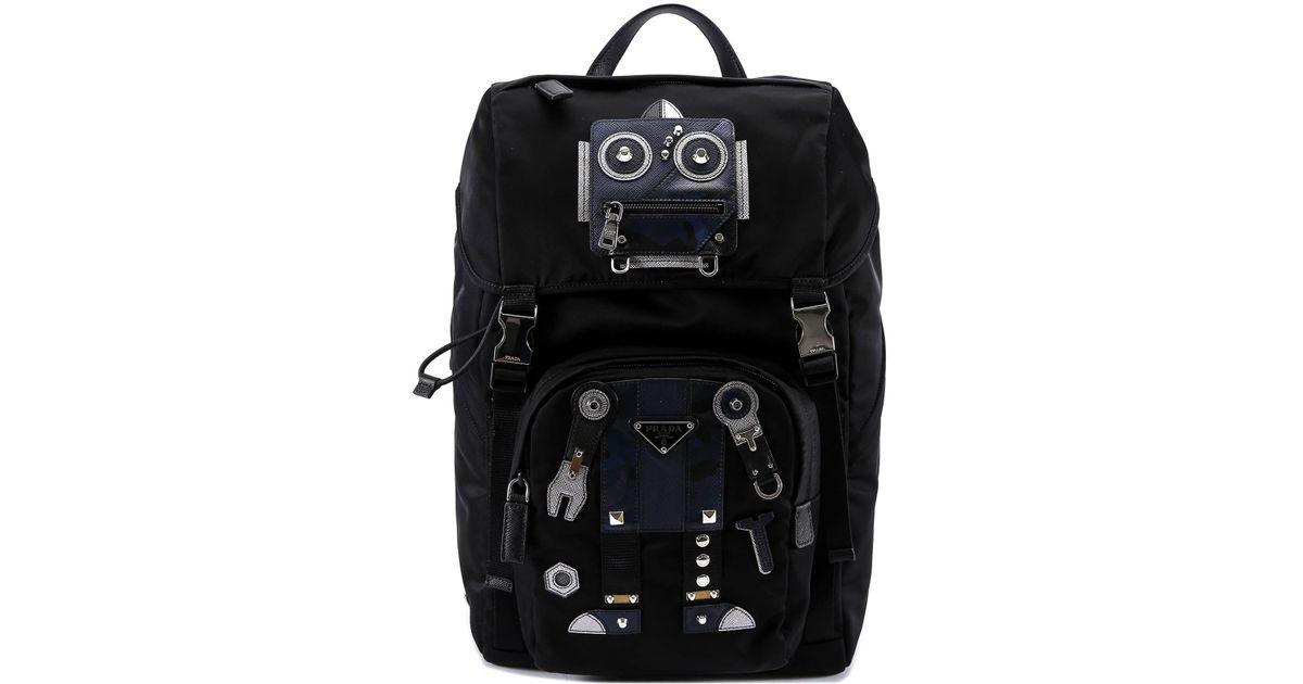 ef94b8ba9aec92 Prada Robot Patch Buckle Backpack in Black for Men - Lyst