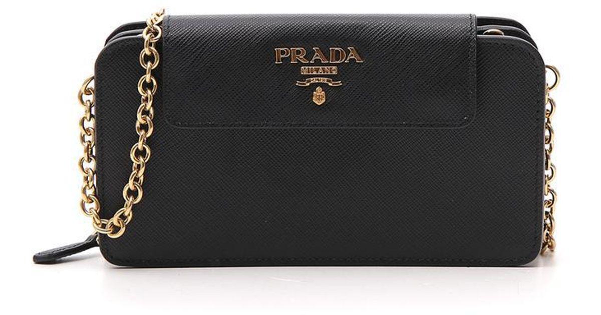 a4072c07ed2922 Prada Saffiano Zip Clutch Bag in Black - Lyst