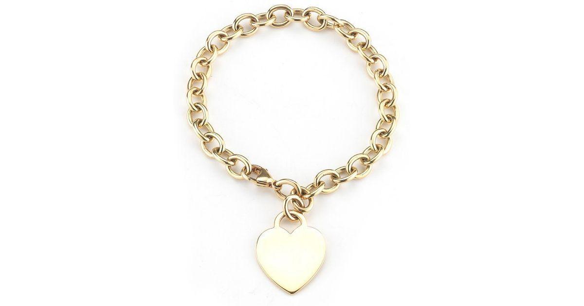 Lyst Tiffany Co Pre Owned 18k Yellow Gold Heart Charm Bracelet In Metallic