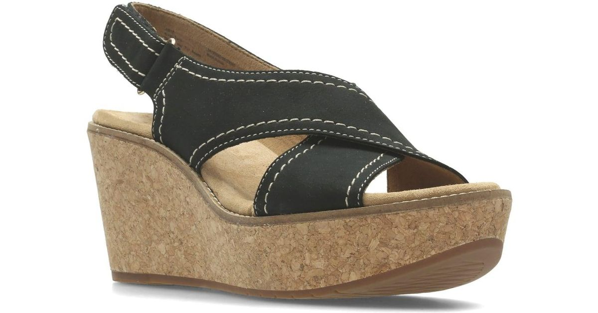aaef9242e76 Lyst - Clarks Aisley Tulip Womens Wedge Heel Sandals in Black