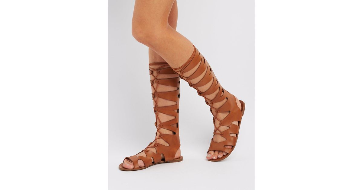 c40ee06bf6d78 Lyst - Charlotte Russe Lace-up Knee-high Gladiator Sandals