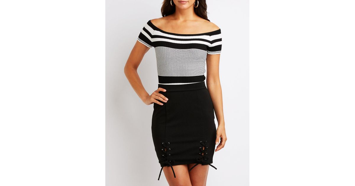 eb0443ab4 Lyst - Charlotte Russe Lace Up Mini Skirt in Black
