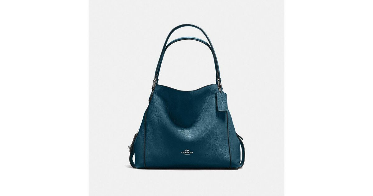 023833c4b0 order lyst coach edie shoulder bag 31 in colorblock with snakeskin in blue  92f0a c3b01