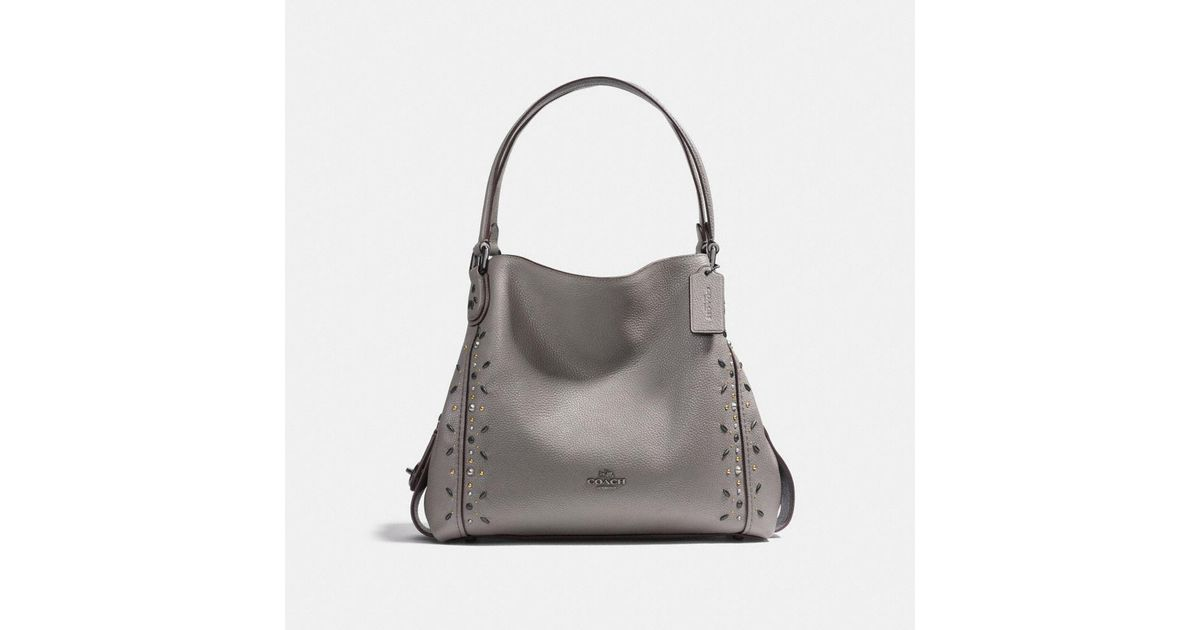 67611282d5 ... italy lyst coach edie shoulder bag 31 with prairie rivets in gray 86e5b  8d931 ...