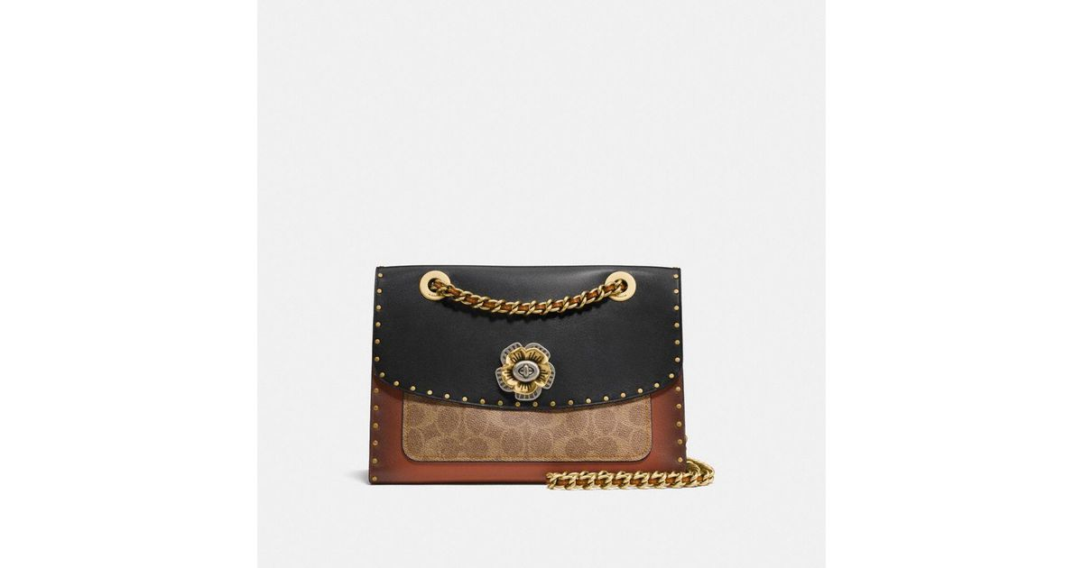 1caec7ee0 COACH Parker With Rivets And Snakeskin Detail - Lyst