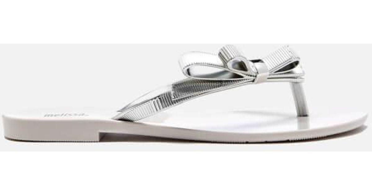afae939265e1 Melissa Women s Harmonic Chrome Flip Flops in White - Lyst