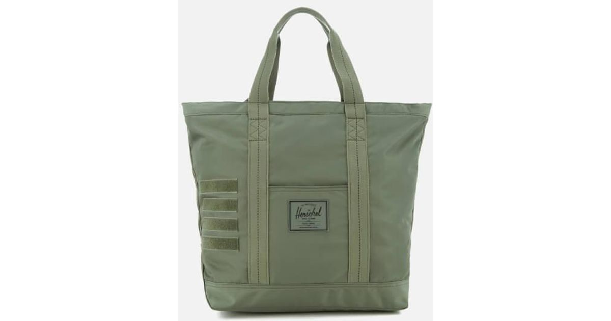 37898c85facd Lyst - Herschel Supply Co. Surplus Bamfield Midvolume Tote Bag in Green