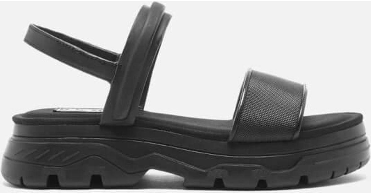 1e040b470d80 Lyst - DKNY Women s Addie Multi Strap Flat Lug Sandals in Black