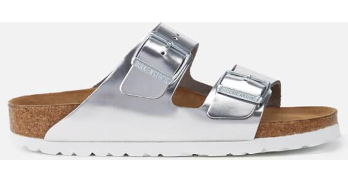 675620c1996 Lyst - Birkenstock Women s Arizona Slim Fit Leather Double Strap Sandals in  Metallic
