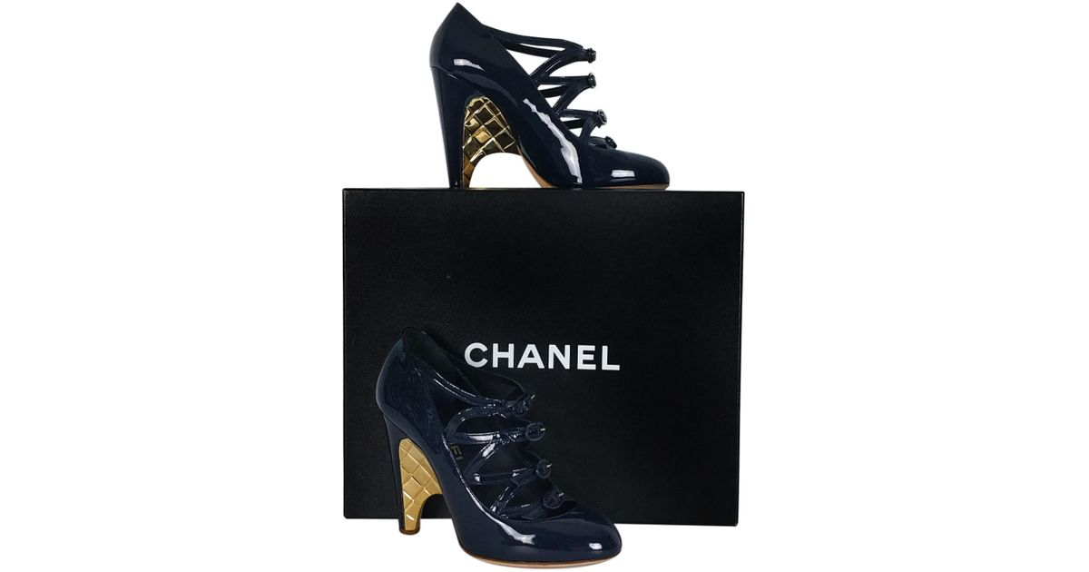 Lyst - Chanel Navy Blue   Gold Wedge Heels in Blue 2e474cc6f