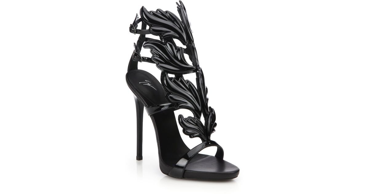 057213eae ... reduced lyst giuseppe zanotti metallic leather wing sandals in black  7cbf7 5340f