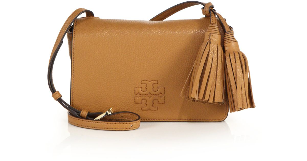 481d255e2b11 Lyst - Tory Burch Thea Mini Leather Tassel Crossbody Bag in Natural