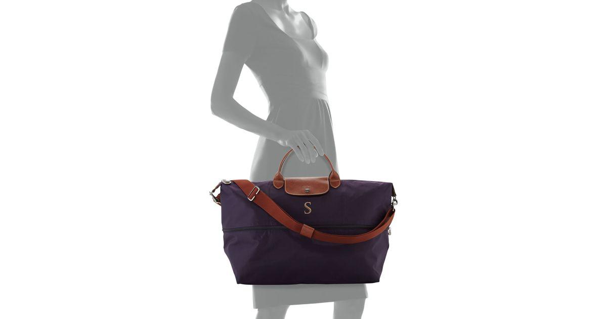 d39d1876ae9b Lyst - Longchamp Le Pliage Monogrammed Expandable Travel Bag in Blue