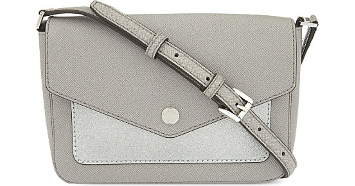 e4fdf1d3c7a4 ... sweden michael michael kors greenwich small leather cross body bag in  metallic lyst a5de5 0aa97