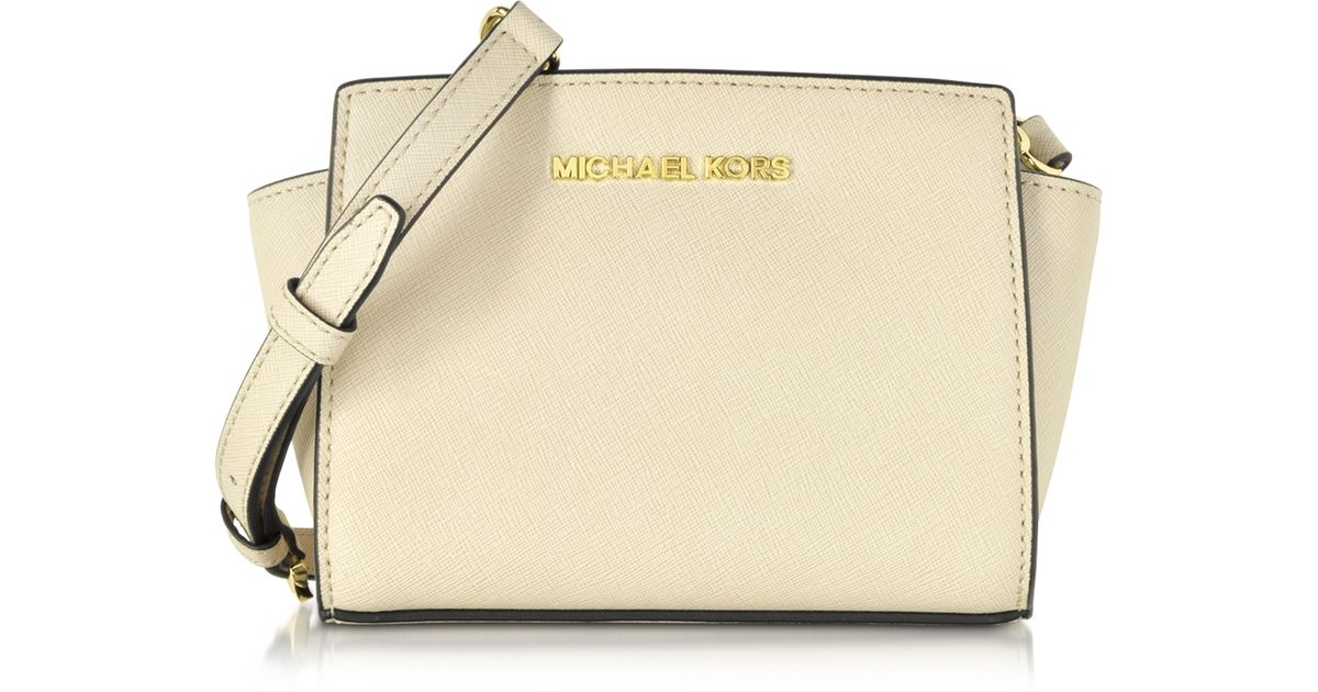 f16e51a7ba22 ... wholesale michael kors ecru saffiano leather selma mini messenger bag  in natural lyst ad6ac db053